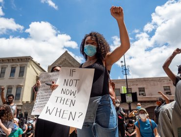 A woman holds up a sign during a Mass Action for Black Liberation protest and march from Washington Park to City Hall following the murder of George Floyd, Saturday, May 30, 2020, in Cincinnati, Ohio, United States. (Photo by Jason Whitman/NurPhoto via Getty Images)