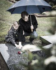 Father and daughter at graveside